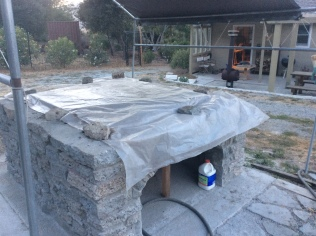 We covered the slab with plastic to ensure a slow, even dry.