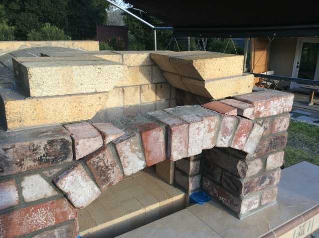 Two courses of firebrick to narrow the flue throat.