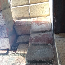 This is at the mouth of the oven looking up the chimney. The facade arch bricks are to the left, and the lintel to the right.